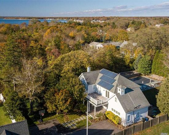 Lovely updated home in beach community. Beautifully maintained with many recent upgrades. This home is move in ready and delightful for a large family or entertaining. Wonderful spacious screen porch overlooks a large fresh water pool and level yard. Landscape design by Marshall Paetzal Landscape Architecture. Includes dock and use of boat slip on Miamogue Lagoon. Truly a North Fork gem.