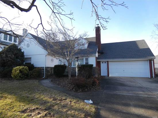 Huge Home with Unlimited Potential Situated on a 80x125 Lot - 3 Full Baths - Expanded in Rear to Include a Huge Dining Room - Master Bedroom on First Floor with Full Bathroom - 6 Total Bedrooms.