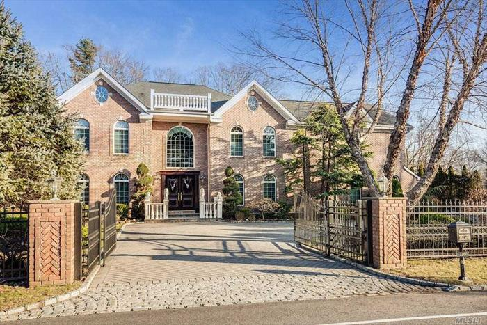 This Stately Brick Colonial Was Completely Renovated In 2001, Boasting 5 Beds/5.5 Baths, 2 Story Grand Entry Foyer, Huge Granite Eat-In Kitchen W/ Center Island W/ Wine Fridge, Stainless Designer Appliances W/ Gas Cooking, Radiant Heated Floor & Double Wall Ovens. Office, Fam Room W/ Wood Burning/Gas Fplc & 4K Projector Theater System, Lr W/ Gas Flpc, FDR W/ Coffered Ceiling, Master Suite W/ Sitting Room & Marble Bathroom W/ Radiant Heated Floors. Gated 1 Acre Property W/ IG Pool/Cabana.