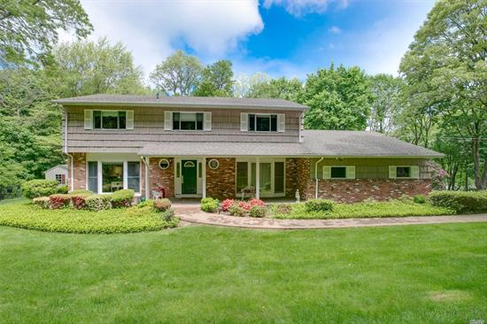 Lovely center hall colonial on private 2 acres. Large formal LR with hardwood floors. Formal DR w/hardwood floors. Spacious EIK w/new refrigerator, Family Room with Fireplace and sliders out to patio, In-ground pool. 2 car garage