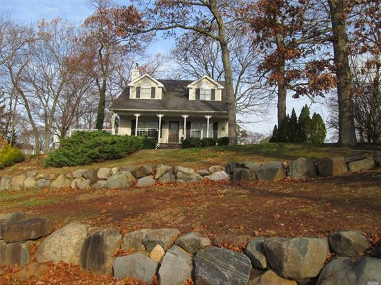 Welcome Home! Feel The Warmth Of This 4 Bedroom Cape Situated On A Shy 1/2 Acre. Hardwood Floors & Hardwood Kitchen Cabinets Adds To The Homes Warmth. Full Basement Is Perfect For Added Storage Or Living Space. Spacious Flat Yard W/Side Deck Is Perfect For Outdoor Activities And Entertaining. Come See For Yourself + Miller Place Schools!