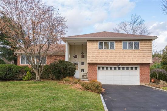 Immaculate, Largest Split Level In the Flower Section. Living Room w/ Fireplace, Formal Dining Room, Eat In Kitchen, Den, Full Finished Basement, Wood Floors under Carpets. Large Yard. This Home is Just Waiting For Your Personal Touches!