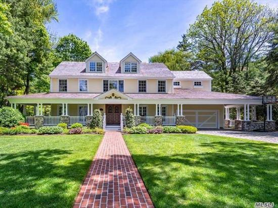 Fabulous Front Porch Colonial on 1/2 acre w/in-ground pool & lush landscaping. This 4 BR 3.5 BTH CH Colonial boasts beautiful architectural details throughout. Gracious CH w/curved staircase leads to large principal rooms, magnificent millwork & perfect flow for entertaining. State-of-the-art gourmet EIK w/custom European cabinets. Palatial in proportion & design. MBR features luxury spa bath.