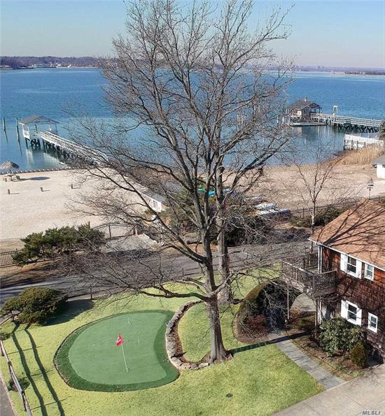 Unique opportunity to live in one of only 3 waterfront homes in Port Washington Estates, now on the market for the first time in 50 years. Enjoy spectacular sunsets from the comfort of the deck outside your master bedroom or go onto the private beach or dock that are just a few feet from your front door. Kayak, sail, fish, swim or just sit under one of the tiki umbrellas. Feel as if you're on holiday, yet you are close to the town, restaurants and the LIRR.
