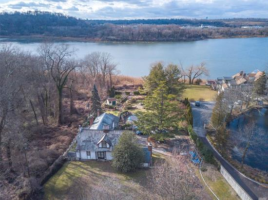 Waterfront! Over one acre, direct waterfront w/Scenic Views of Roslyn Harbor.Brick and Stucco Colonial circa 1920 w/creative imagination & tender loving care transform this property w/ untapped potential to your dream home. Newly Expanded Family Rm w/ Fireplace & Marvin Windows.Large Living Room& Dining Room w/FP. Huge Master Suite w/ stunning views of the water & grounds. Gunite Heated Pool. Plenty of room for expansion.Beautiful British-style gardens w/specimen plantings stretching to water.
