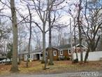 Ranch situated on 1 acre property is bank owned--sold as is.