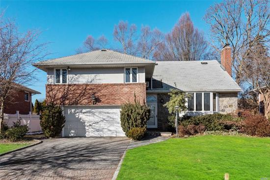 No, You're Not Dreaming! Come See This Large Split Located In The Beautiful And Coveted Syosset! Featuring A Living Room With A Wood Burning Fire Place Perfect For Entertaining, A Large, Sun-Filled Kitchen, Plenty Of Living Space, And A Basement For Storage! With Great Convenience To Transportation, Shopping, And Dining, This One Has Everything You Could Ask For! Hurry In Before It Becomes Someone Else's Dream Home!