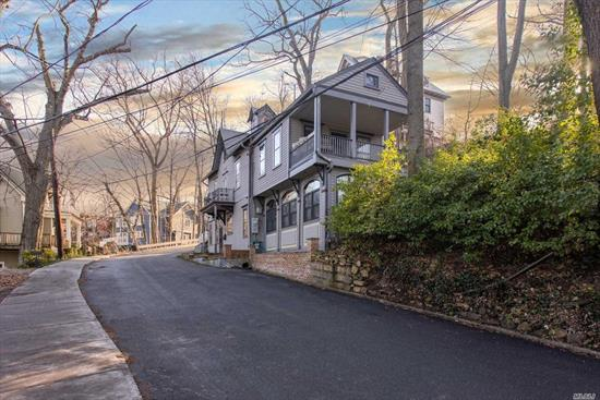 Historic Harbor Side Home! Original Carriage House Of The First Mayor Of Sea Cliff! Wonderful Water Views! Close To Sea Cliff Beach & Boardwalk. Granite Counters & High End Stainless Appliances.Great Room W/ Radiant Heat & Gas Fpl, French Doors Leading To Patio & Expansive Front Yard. Master Suite On 2nd Floor W/ Wood Burning Fpl, French Doors Leading To Veranda W/ Harbor Views! North Shore SD & Beach Rights! Your Dream Awaits!