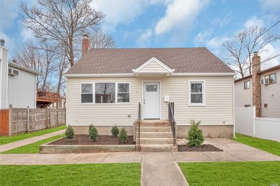 Beautifully Renovated. All New Roof, Siding, Gas Heating, Windows, Baths and Kitchen w/SS Appliances. Hi Hats Throughout. Finished Basement makes a great Party or Play Room. Low Taxes. Private Yard.