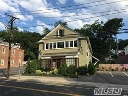 :*Prime Location* Office Building With Water Views Of Cold Spring Harbor On Main Street (25A) Lower Level Offices, One with Window, Built-In Counter, Sink, Cabinets, Private, Second Office Furnished with Desk, Chairs, Bookcase & Window *Utilities Included!* *Great Opportunity For Cold Spring Harbor Office Address.*