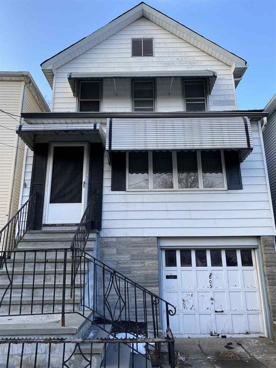 Let Your Imagination Run! Lovely Single Family Home W/ Garage In Need Of Some Cosmetic Renovations. Easily Turned Into A Beautiful Home! Located On A Quiet Residential Street Just A Few Blocks From James Braddock North Hudson County Park And Near Nyc Transportation.