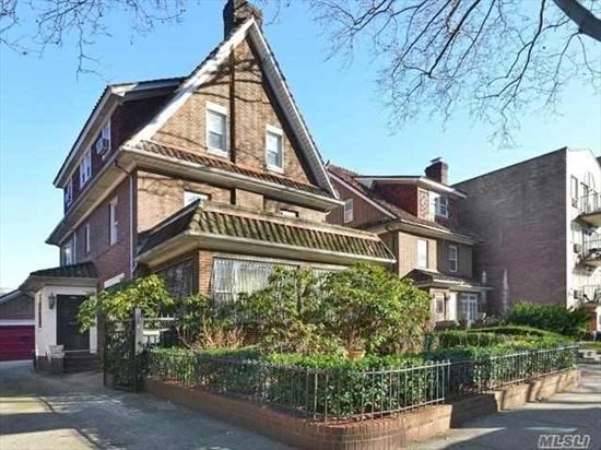 Rare Opportunity in the Historic District. Unique detached stately English Tudor with landscaped front garden and a rear private brick patio. Property features a large private driveway and 2-car garage. This well-maintained bright and airy home features abundant charm, as well as, a fireplace and many upgrades. Neighborhood boasts a playground, as well as, many restaurants, and a farmer's market. Convenient to shopping, schools, and restaurants. 20-minutes to midtown Manhattan via #7 Subway.