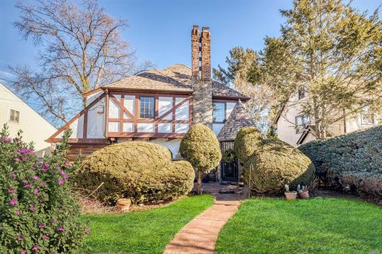 Welcome the year 2020 in this lovely 3 Bedroom 1.5 bath Tudor with a full basement, wonderful Sunporch and newer roofing located in a once gated community in the Manor Estates. Settle in to this Cul-De-Sac home and enjoy the wood burning fireplace, formal dining room and spacious bedrooms. Near all transportation and college campuses. It has plenty of possibilities for living and storage space.