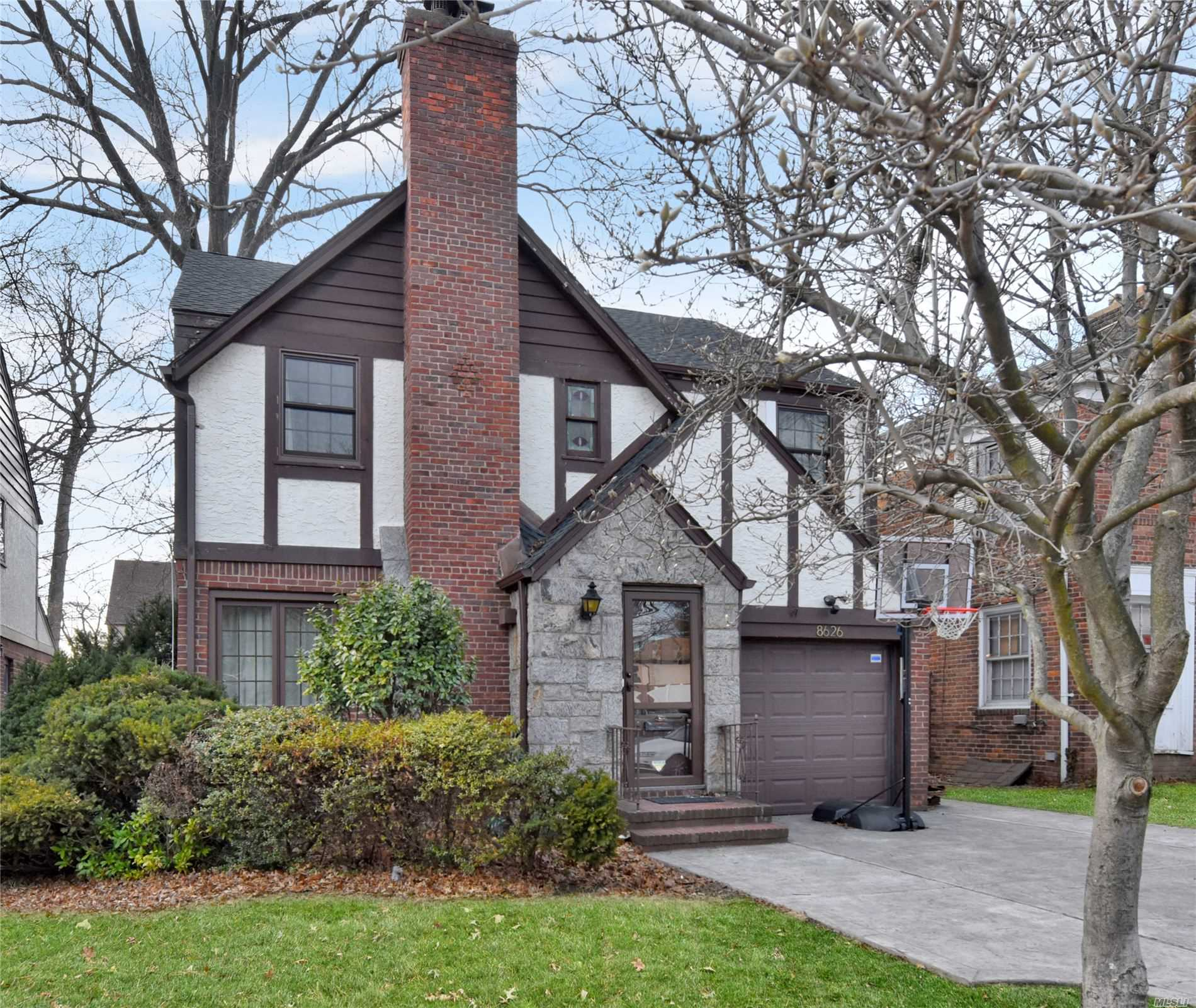 Attention Tudor lovers! A Spacious Home featuring 4 Bedroom, 2.5 Bath Colonial Is Perfectly Situated On An Oversized Lot On A Quiet Block In Jamaica Estates. This Gracious Home Is Loaded With Fine Tudor-Style Accoutrements, Such As Exposed Brick Interior Walls On Two Floors, Stained Glass Windows, Arched Niches, Moldings And Exposed Beams. New Windows, Roof, backyard, driveway, Water heater, and plumbing and electric.LED lights.New stainless steel appliances. Heated garage, and much MORE. SD26.
