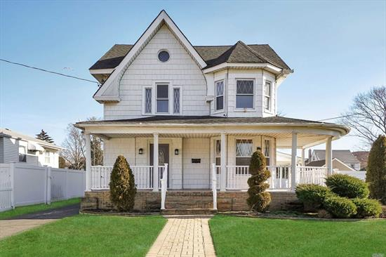 Elegant 1905 Queen Anne Victorian, 5Br, 2.5Bths, New Reno, Beautiful Covered Front Wrap Porch & Back Porch, Eat-In Kitchen Custom Grey Cabinets, Granite Counters, SS App's, Mud Rm Leads to Cvrd Back Porch, Powder Rm/Laun Rm, FLR, Rm, FDR w/ Wood Burning Frplc, Sunken Great Rm W/Wall of Windows Open up to Private 75x150 Bkyd, High Ceiling/Crown & Flr Moldings, Huge Mstr Ensuite w/Cathedral Ceil, Fin Walk up Attic: 3 Rms/Bth. Full Part Fin Bsmnt, Ose, Rec Rm, 2 Car Garage 8 car Driveway