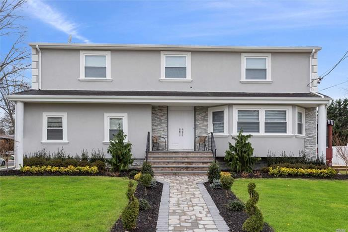 Fabulous Colonial W/Brand New Stucco & Stone Exterior, New Windows, Formal Living Rm, Formal DR, EIK, Den W/Skylight & Fireplace. Master BR W/En-suite Bath, 2 Walk-In Closets, 3 Additional Bedrooms, 1 Bath, Finished Basement W/Family Rm + 4 Room Suite W/Separate Entrance Can Be Professional Office W/Proper Permits.