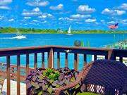 High ranch located directly on the water, With oversize Property and dock. Come Live By The Beach!  Private Beaches For Residents and Guests, Tennis Center, Fine Dining, Boardwalk. Close to Manhattan and JFK. and Provides 24/7 Village Security. A Boaters Paradise! new buclkhead