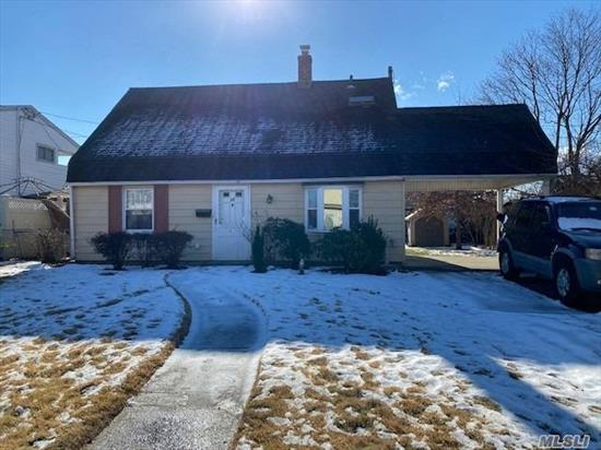 Great Opportunity To Make This Home Your Own. 2nd Floor Has Two Unfinished Rooms For Expansion Of Living Space. Backyard, Carport, 2 Entrances, New Washer/Dryer.