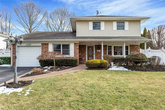 :Lovely Home In Smithtown Schools...Spacious Colonial~Splanch Beautiful Setting Large Entry Hall Custom Molding Throughout.. Offering 5 Bedroom , 2.5 Bths, Lg. Eik, . Light and Airy Layout, Main Level BR with 1/2 Bath (Space for Full), Hardwood Flrs, Updated Windows/Cesspool/Electric/Master Suite with Updated Full Bath, Walk-In, Floored Attic Storage, Country Club Backyard with IGP and Waterfall.