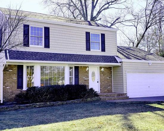 This 1, 883 sf Colonial Style Home features 3 bedrooms, 2.5 baths w/ new designer kitchen and new baths. Refurbished wood floors, fresh paint, new roof, new siding, etc. over sized back yard. Quiet tree lined street. Centrally located to all. Don't miss this opportunity!