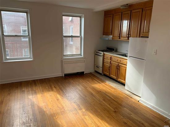 Studio on top floor with awesome sunlight in a great location - doorman building and outside courtyard - Tiled windowed bathroom/dressing room and two closets Nice size living space with beautiful hardwood floors. Close to all transportation and all the good shopping/restaurants etc. that Forest Hills has to offer