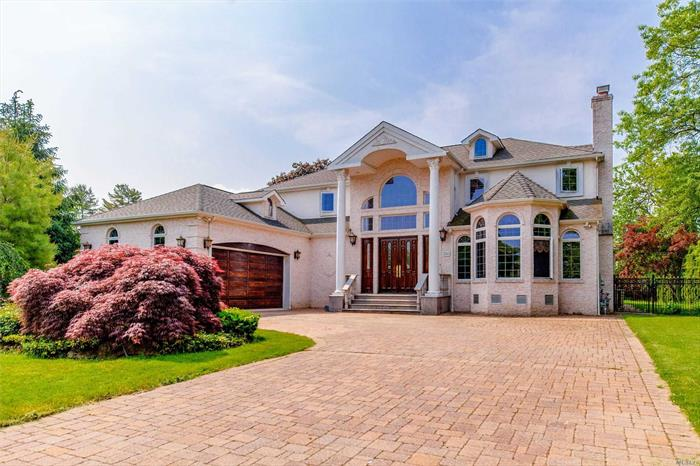 Built in 2005 Colonial Property, Luxury Custom Built 4 Beds &3Baths &2 Half Baths Brick With Magnificent Details Throughout. Full Basement W/Home Theater, Sauna room, 2 Garage W/ Private Driveway, First And Second Floor have Master Beds&Baths , Gunite Pool And You Can Not Missed!