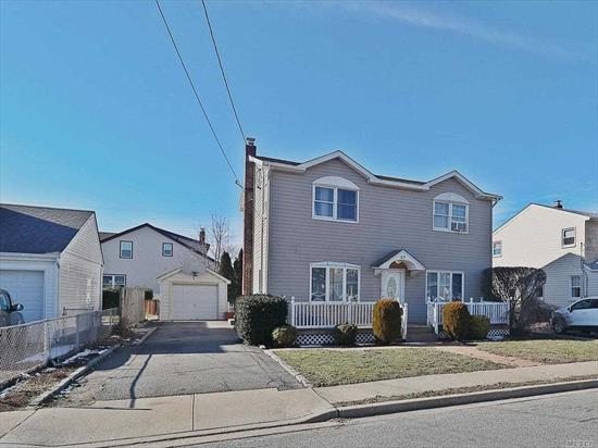 Unique Colonial centrally located next to LIRR, Broadway Mall, LIE/Northern State/Wantagh Parkway, and all major local roads. Unique wood-work and stone-work interior with three bedrooms and 2.5 baths. Master BR suite features a huge master bath with jacuzzi tub. Finished basement, Trex Deck, Detached one car garage, long driveway, granite kitchen, and so much more. Very rare find!