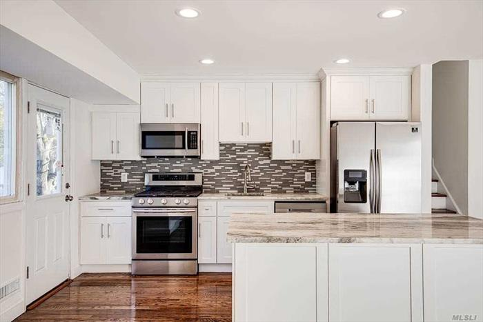 Wonderful new renovation in award winning Commack school district. Close to all highways, shopping & transportation. Convenient Mother Daughter layout for mom / kids who so happen to need their own personal space w/ their own full baths & entrances. Generous set-back from road, w/ granite countertops & stainless steel appliances surrounded by elegant grey & white, modern finishes. Or, simply, advise the builder seller of any special customizations akin to your very own likes, wants & needs.