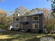 Just like new- everything has been renovated- beautiful colonial on 1.35 acres in wooded quiet area. Best value in Sagaponack.