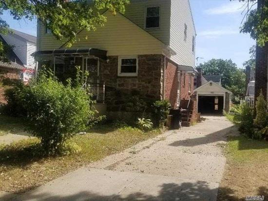 Newely Renovated Home On A Quiet Tree Lined Block. This Home Have 5 Bedrooms 3 Full Baths, Hardwood Floors, New Kitchen, Garage with Private Driveway, Finished Basement & Lots More. Perfect for All. Close To Places of Worship, NYC , JFK & MaJor Highway.