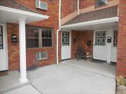 Turn key first floor condo. A wonderful opportunity to own in a quiet complex centrally located to train, shops and parkways. Updated kitchen, dining room, large living room, king size bedroom, bath with tub and hardwood floors. A must see.