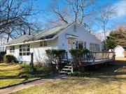 Perfect Location in Town! An Adorable Fixer Upper Full of Character and Awaiting Your Design. 2 Bedrooms and 1 Full Bath. A Fantastic Spot on a Quiet Street Overlooking the Private Golf Course in Laurel. Close to all the North Fork has to Offer