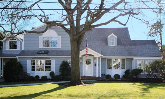Stunning Center Hall Colonial in Prestigious Old Harbour Green* 1st Floor Boasts: Beautiful Large Living Rm w/ Gas Frplce & Mahogany in-laid Hardwood Flrs w/ French Doors to Charming Heated Sun Rm* Banquet Dining Rm w/Wainscoting* Gorgeous Granite Eat-in-Kit w/Skylight* Skylit Den w 2nd Frplce & Lovely Pwdr Rm* 2nd Floor Boasts: Master Suite w/ New Marble Bath plus 3 Additional Bdrms w/2nd Bth & Upstairs Laundry Rm* Radiant Ht in Sunrm & All 3 Baths* Harbour Green Shore Club & Marina Eligibility