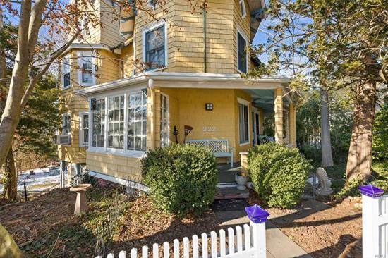 The Yellow Lady welcomes guests to explore her history and experience the grace, style and architectural details that envelop this Victorian charmer. Offering six bedrooms, two full baths and one half bath, this special home has been lovingly updated, adding comfort and convenience for today's lifestyle while maintaining the charm of yesteryear. The beautifully landscaped grounds catch the breeze from Hempstead Harbor. Just a short stroll from all that Sea Cliff has to offer.