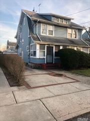 Great Opportunity legal 2 family for investment or owner income-producing property on a quiet street in the Village of Lynbrook. SOLD AS-IS Each unit features a spacious layout with LRs, EIK, 2 bedrooms, full baths, and enclosed porch. First floor has rear porch exit and basement access. Basement has OSE for 2nd flr tenant access. 2nd flr has a large walk-up attic. Two car garage with private driveway. Residential A zoning.