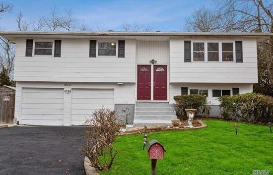 :Move Right Into This Updated And Spacious Home, Complete With NEW Windows, NEW Driveway, Updated Baths, Gleaming Hardwood Floors Throughout, this Fabulous Home Includes Many Updates including Updated Large Eat In Kitchen. All this located In Harborfields SD #6! Possible Mother Daughter with Proper Permits. A MUST SEE!