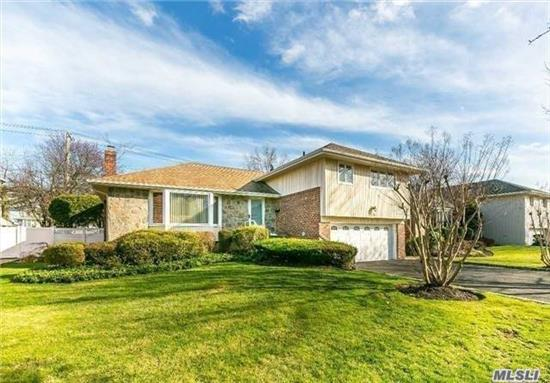 This Spacious Home Has Beautiful Curb Appeal Located On A Quiet, Tree-Lined Street, It Is In The Perfect Location Featured Gorgeous Hardwood Floors and Many Updates. New Kitchen, New Baths, New Floors, New Walkway & Driveway and Close To All.