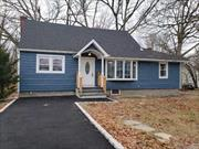 This is a Beauty! you will love this recently renovated Ex-Cape. All you need in a house. A most see. 4 Br's, Master with Bath, Large Den with stoned fireplace with exposed beams, Open concept Living Room following the lovely eat in kitchen with granite tops and center Island, 3 gorgeous baths.