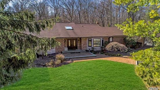 Luxury Living in North Syosset.This contemporary expanded ranch features 5 generous bedrooms 4.5 baths.The interior offers soaring ceiling and open floorplan-an entertainers dream!The oversized gourmet kitchen with a chef's appliance package overlooks the Koi Pond.The Master suite is equipped with separate sitting room/office.Close to LIRR, Berry Hill/S-Woods Middle.