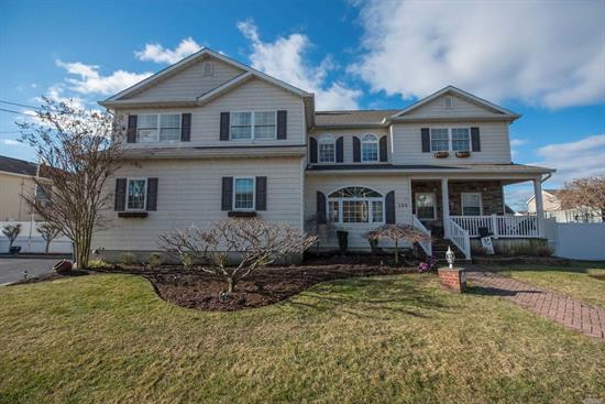 Rare Find - 5 BR, 3 Bath Colonial w/Legal Accessory Apartment. Boasting 2 Kitchens , Living Room w/ fireplace, Dining Room, Full Finished Basement with OSE. Large Yard with Detached garage, Central Air. Requires No Flood insurance. Must See!