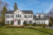 5 year young Colonial set back on 2 acres in Cold Spring Harbor SD! Built by renowned local builder & features exquisite mouldings & craftsmanship throughout. Enjoy modern amenities from the 1st fl ensuite bedrm & mudrm to the 2nd flr laundry rm & master en-suite w/ 22'x14' WIC! Elegant white kitchen w/ marble countertops & prof appl adjoins fam rm w/ fpl. Expansive flat usable rear property w/ room for a pool. Minutes to Lloyd Harbor Village Beach w/ tennis, Summer camp, & mooring rts (fee).