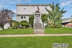 Clean & Meticulous Colonial Located In Lindenhurst. This Home Features Hardwood Floors, Solar Panels, Recessed Lighting, Living Room, Dining Room, Kit W/Custom Cabinetry, SS Appls & Granite Counter Tops, 3 Bedrooms, 3 Full Baths, Full Basement W/Storage & Utilities, Brick Patio, Fully Fenced Private Yard. Close To Schools, Shopping, Restaurants & Transportation.
