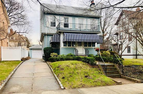 Great location of beautiful Flushing North! Quiet mid block. Near Bowne Park. Updated kitchen and bath, formal dining with fireplace, front sun porch, 5 bedrooms in very good sizes, den could be the 6th bedroom!! New Hardwood floors!! huge backyard and beautiful garden. long driveway fits 4-5 cars, garage. Walking distance to Northern Blvd, buses and L.I.R.R.