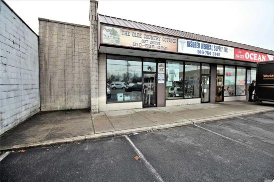 High Visibility Location, Large Corner Store In Shopping Center On Long Beach Road with ample parking. Ideal for professional business or retail/commercial operation. Recent DOT survey traffic analysis indicates 53, 000 Plus vehicles a day pass this location. On-site parking.