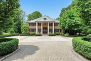 Elegant 5 bedroom Brick CH Colonial offers stunning entertaining spaces with approx 5400 sq ft of luxury on 1 acre of lush property in Flower Hill. Stylish Entertaining rooms include LR w fpl, Gourmet Rutt kitchen w breakfast room which flows into Family Room w limestone fireplace, Formal Dining Room , den/office , Grand Master Suite with fireplace, spa like master bath & walk in closets & Sitting Rm/Office. Beautiful architectural details & design make this home truly exceptional in every way.