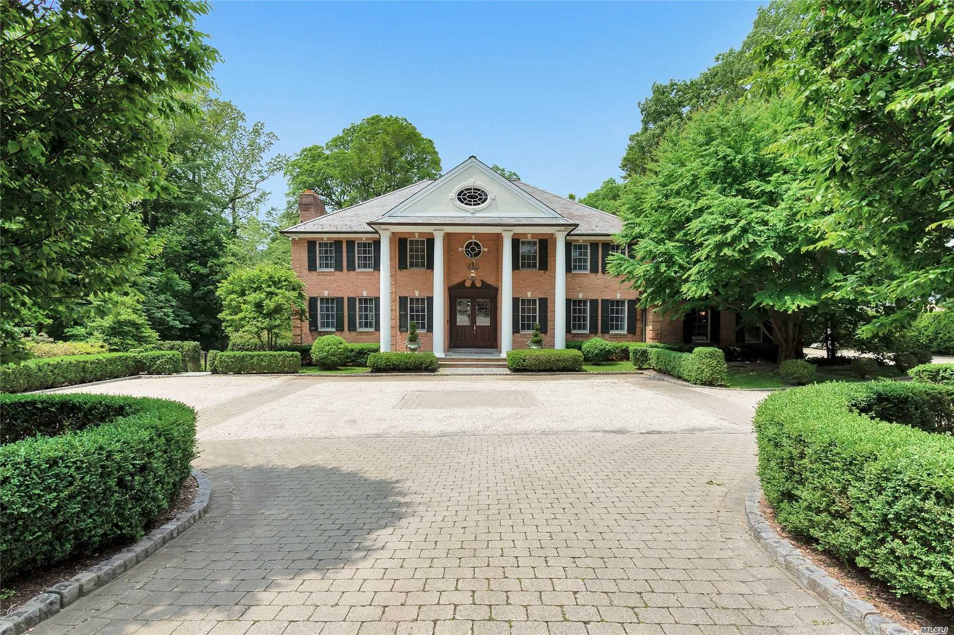 Elegant 5 bedroom Brick CH Colonial begins at the impressive entry foyer leading to stunning entertaining spaces with approx 5400 sq ft of luxury on 1 acre of lush property in Flower Hill. Stylish & spacious Entertaining rooms include LR w fpl, Gourmet Rutt kitchen w large center island , two dishwashers, walk in pantry,  sun filled breakfast room which overlooks the tranquil property,  patio & organic gardens,  The kitchen flows into a large Family Room w limestone fireplace, Formal Dining Room , den/office , An impressive & Grand Master Suite with fireplace, spa like master bath ,  walk in closets & Sitting Rm/Office/Nursery will be a favorite.  Beautiful architectural details & design make this home truly exceptional in every way & one not to be missed.