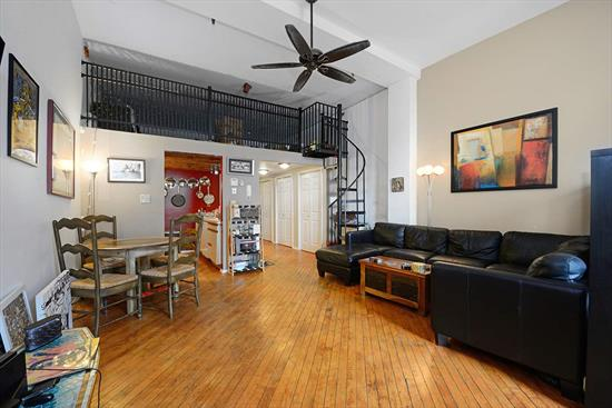 Bright, Loft Style Unit In Historic Factory Conversion Building With Parking Included On One Of The Most Desirable Streets In Jersey City Heights! This Creative Open Space Is Designed For Maximum Efficiency With An Additional 130+ Square Foot Sleeping Loft. Hardwood Floors Throughout, Modern Kitchen And Bathroom, Very High Ceilings And Oversized Windows With Southern Exposure. Elevator Building With A Common Yard, Storage Room, And Bike Room. Laundry On Every Floor. Close Proximity To Train Station, Hoboken, Light Rail, Bus To Nyc, Local Parks, Community Garden, Shopping And Restaurants.