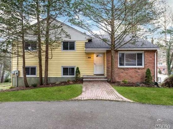 JUST RENOVATED-LIGHT, BRIGHT & MOVE IN READY!!! Fabulous Redone Split Featuring Open Floor Plan, Beautiful New White EIK w/SS Appls, Granite Countertops, Lrg Peninsula Island & Sliding Glass Door that lead to Elevated Deck Overlooking Magnificent landscaped property. New Bathrooms & Refinished Hardwood Floors thru out. Unfin Bsmt Part Above Ground w/lots of natural light, Lrg Windows & Sliding Doors that lead to backyard. New Roof, CAC, 2.5 Car. CLOSE TO ALL- Syosset-Walt Whitman/HBT. MUST SEE!!