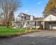 In East Moriches'most desirable neighborhood, you'll find this nearly 3000 sqft postmodern home on a flag lot. Enter via a private gated drive into your own 1.2 acre fenced sanctuary. Natural wood abounds in this light filled home. Everything has been updated & beautifully maintained. Eat-in-kit w/stainless & Granite. Double sided fpl between LR & FDR. Huge MBD Suite w/fpl + add'l 3 BDs & 2 1/2 bths. The backyard is vast & features a 20'x40' pool w/ brick surround. Garage, Full Basement.