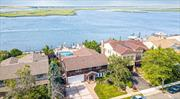 Gorgeous Bayfront Mint Condition Splanch Style Located On Cul De Sac. This Incredible Home Features 4 Bedrooms And 3.5 Baths With Waterfront Views From Two Bedrooms, Gourmet Chef's Kitchen With Granite Center Island Countertops and Top of the Line Appliances. Outdoors Features Bulkhead And Dock, Outdoor Shower, Fully Equipped Covered Outdoor Kitchen, Large In Ground Salt Water Pool, Paver Stones, With Incredible Bay Views. Proximity to Beach, Houses of Worship, Golf Course, Lirr and Parkways!